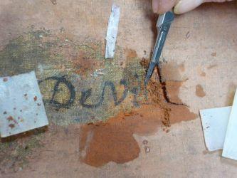 Dégagement d'une inscription au revers d'une toile
